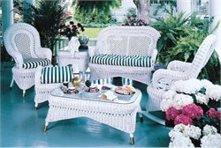 Available in white only. A natural wicker seating set with antique style details. This set will take you back to a bygone era when everyone would entertain on their front porch. Also perfect for a sunroom or any living area in your home. Includes a wicker loveseat, rocking chair, armchair and coffee table with the fabric of your choice. Ships in 4 weeks. Country Porch Wicker Set of 4 Measurements: Victorian Arm Chair 26