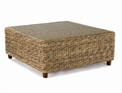 40w-40d-17h. The Tangiers seagrass coffee table features a tempered glass top and wood feet. Ships in 1-2 days.